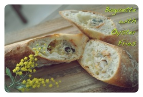 Baguette filled with fried breadcrumbed oysters